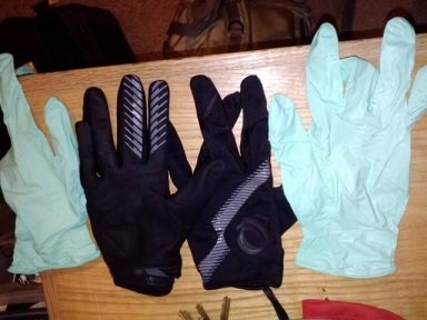 Thin full finger gloves with exam gloves over the top.