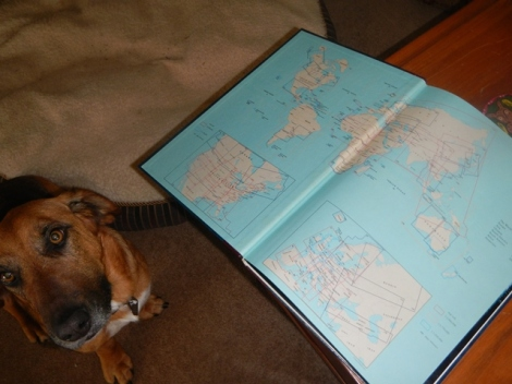 Levi helping to evaluate the world via a table top atlas.