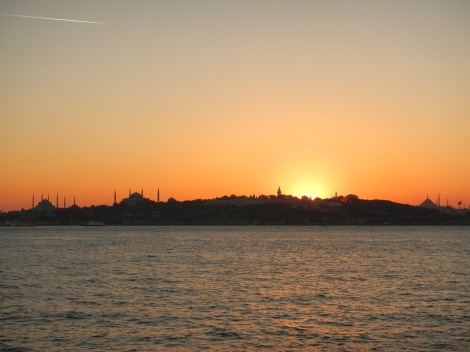 Sunset over Istanbul - the Blue and Sophia Mosque are silhouetted.