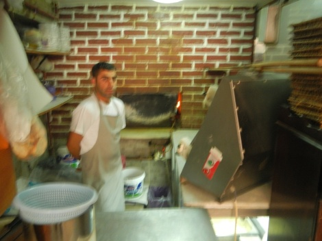The chef with the fire oven behind the steal plate.