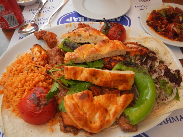 Mixed Kebap with the flat bread on top.