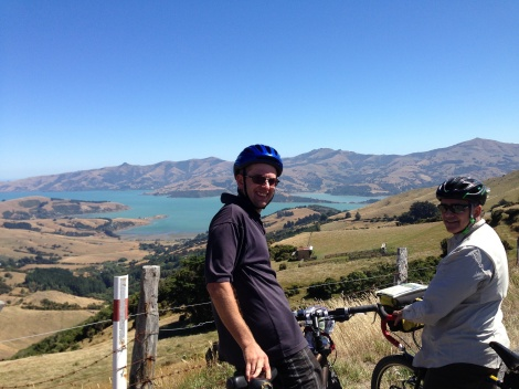 Chris looking down on Akaroa Harbor from Summit road. All downhill from here.