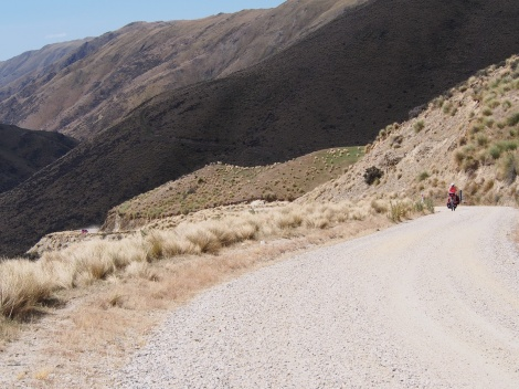 JP slowly grinding up the road- the car below gives a good idea of the steepness.