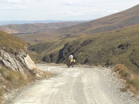 Heading down into the headwind in deep, loose gravel.