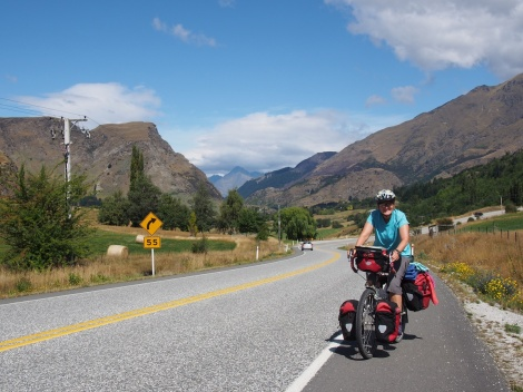 Climbing up to Arrowntown - queenstown in the background
