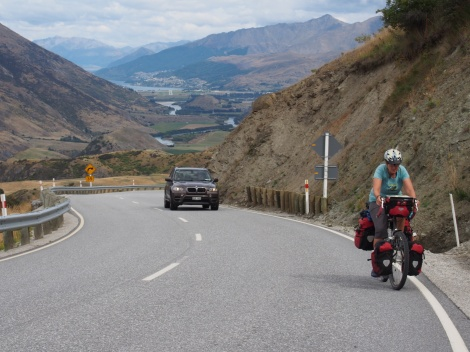 JP climbing to the summit - Queenstown in the background